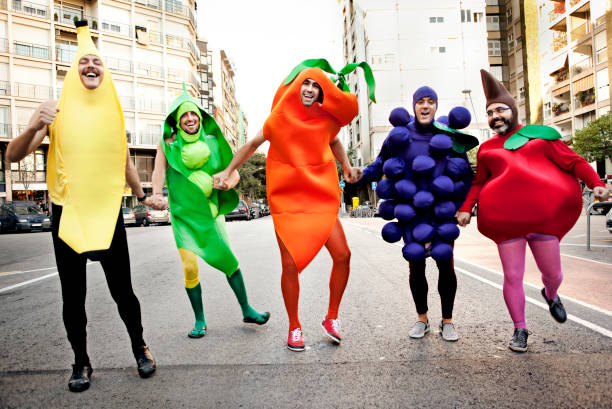 Vegetables Five men dressed up like vegetables running in the street costume stock pictures, royalty-free photos & images