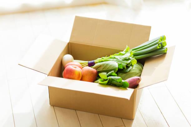 Vegetables put in cardboard stock photo