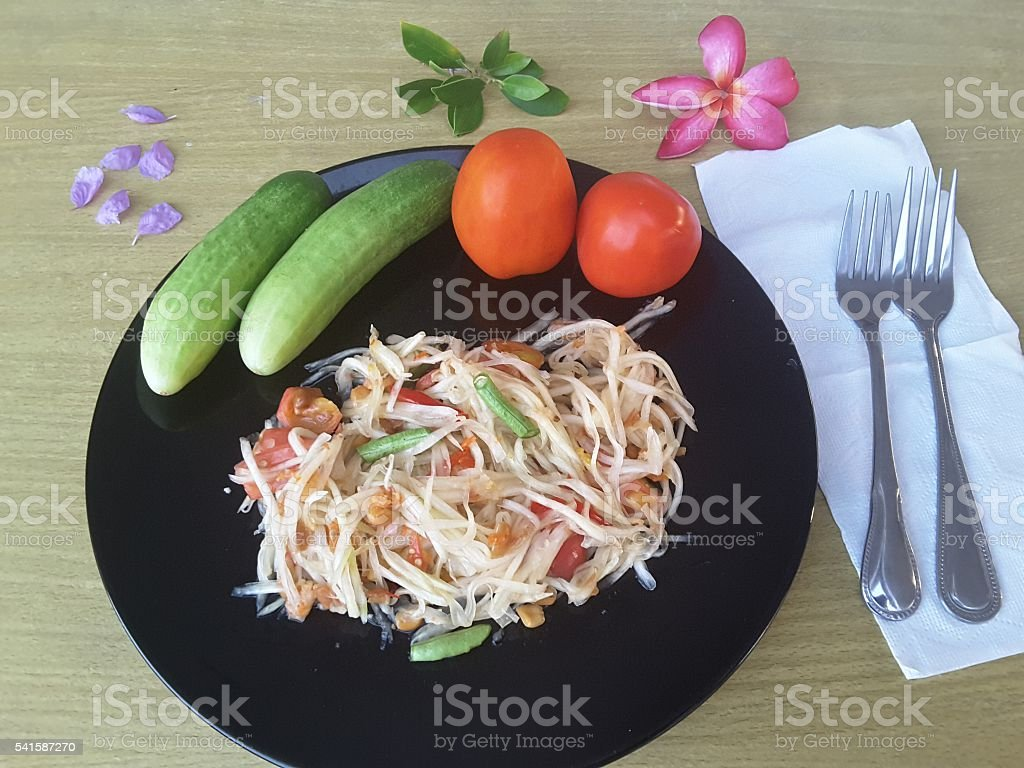 Vegetables salad  on plate, cucumbers and tomatoes стоковое фото