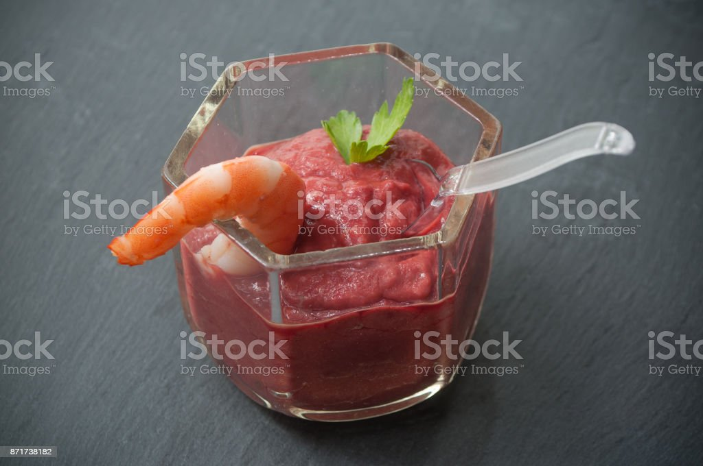 vegetables smoothie with beet, avocado and carrot with decorative shrimp stock photo