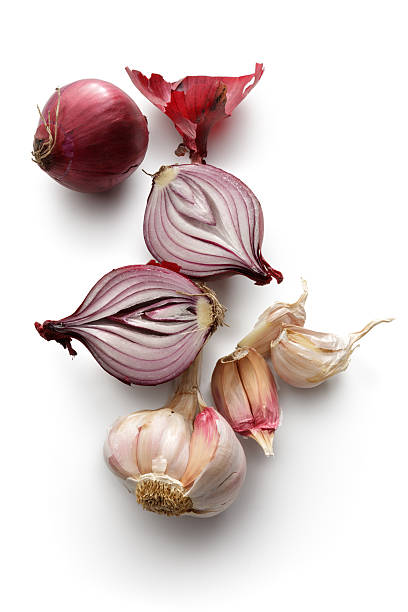 vegetables: spanish onion and garlic isolated on white background - garlic stock photos and pictures