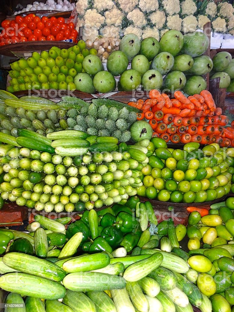 Vegetables Stacked in a Market stock photo
