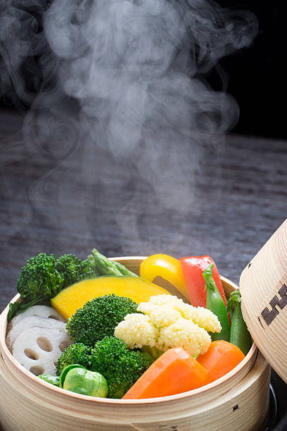 vegetables steamed - gestoomd stockfoto's en -beelden