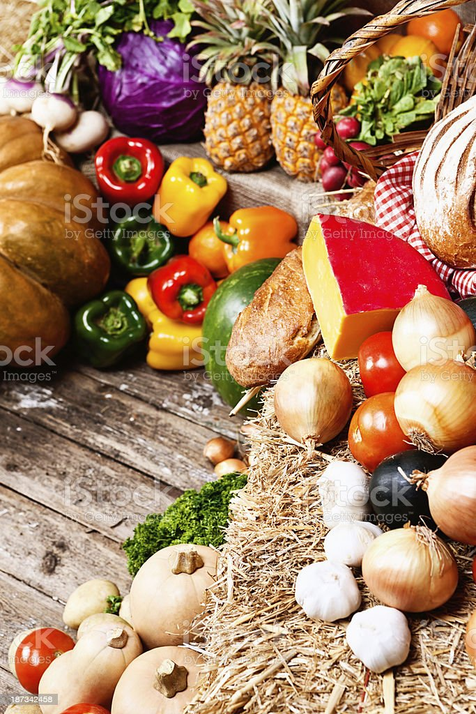 Vegetables with bread and cheese in rustic arrangement at market royalty-free stock photo