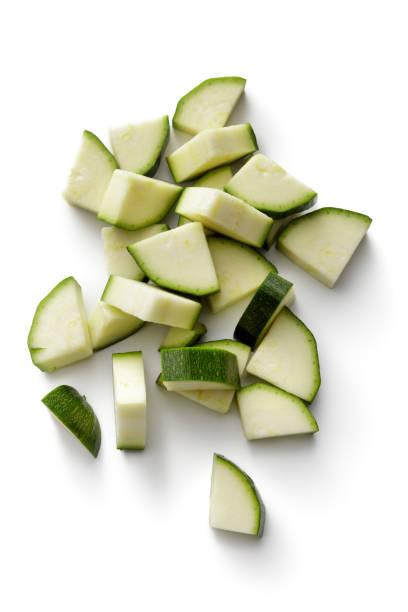 groenten: courgette geïsoleerd op witte achtergrond - courgette stockfoto's en -beelden