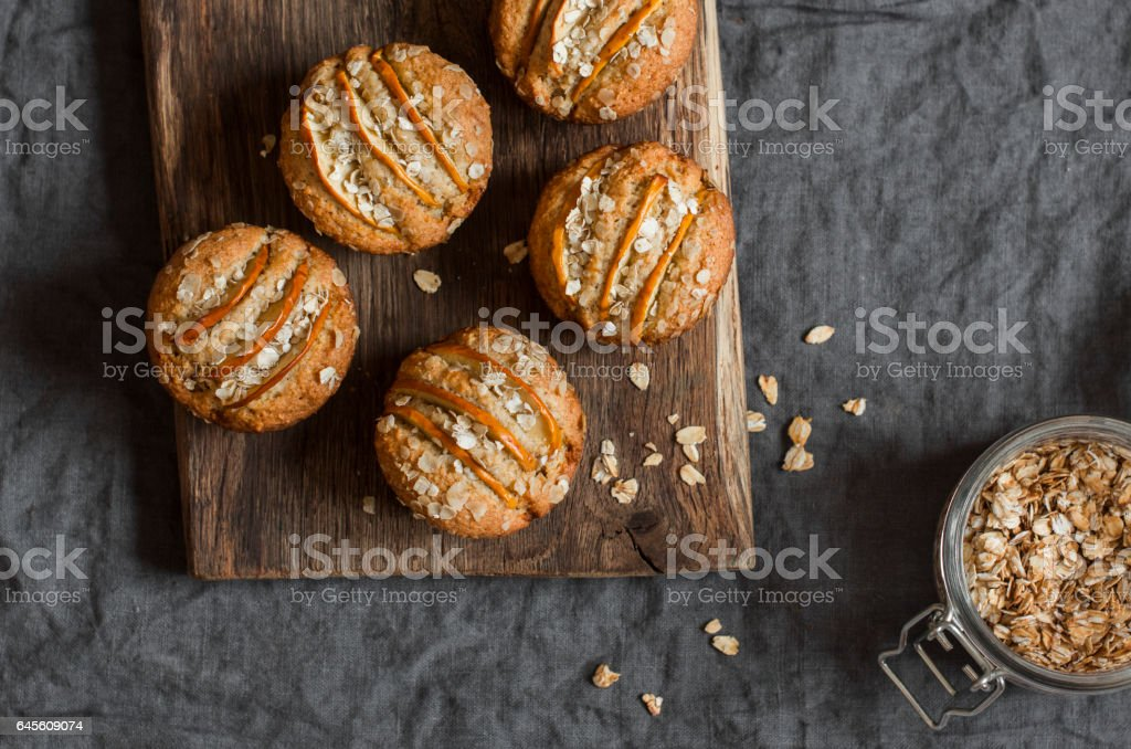 Vegetarian apple oat muffins on dark background, top view stock photo