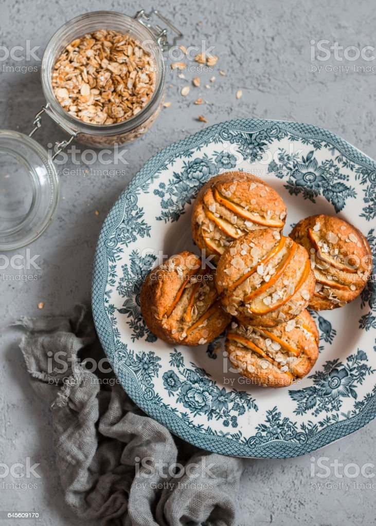 Vegetarian apple oat muffins on light background, top view stock photo