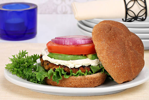 Vegetarian black bean burger on a whole wheat roll. stock photo