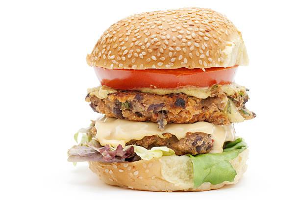 vegetarian black bean cheeseburger on bun stock photo