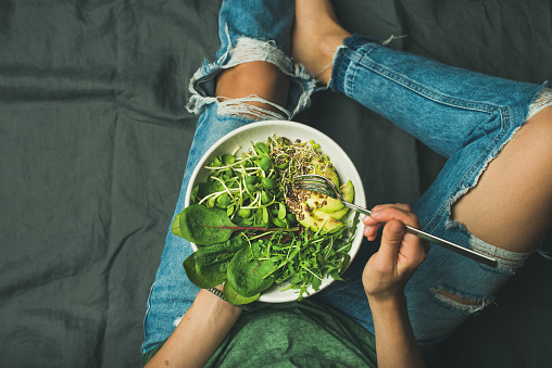 istock Vegetarian breakfast bowl with spinach, arugula, avocado, seeds and sprouts 692990626