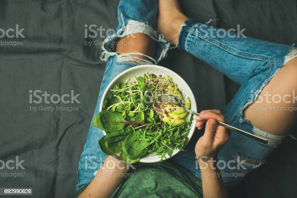 Vegetarian breakfast bowl with spinach arugula avocado seeds and picture id692990626?b=1&k=6&m=692990626&s=612x612&h=o7ur4eksdtwxg jzxkw1qpnc9zoosdbw2gkekwzdzly=