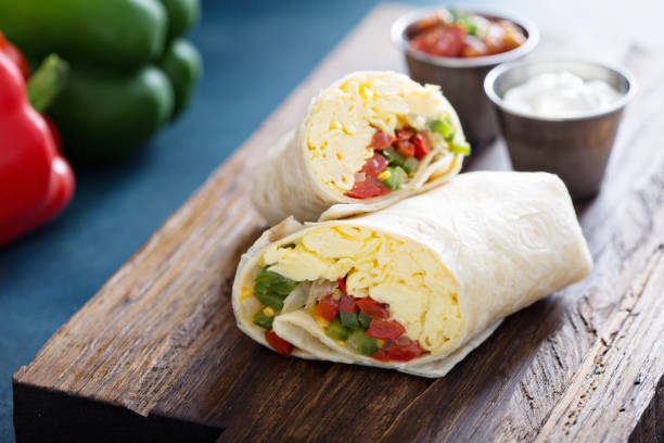 Vegetarian breakfast burrito with eggs Vegetarian breakfast burrito with eggs and bell pepper breakfast stock pictures, royalty-free photos & images