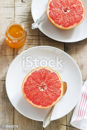 Vegetarian breakfast for two of baked grapefruit. Rustic style, selective focus.