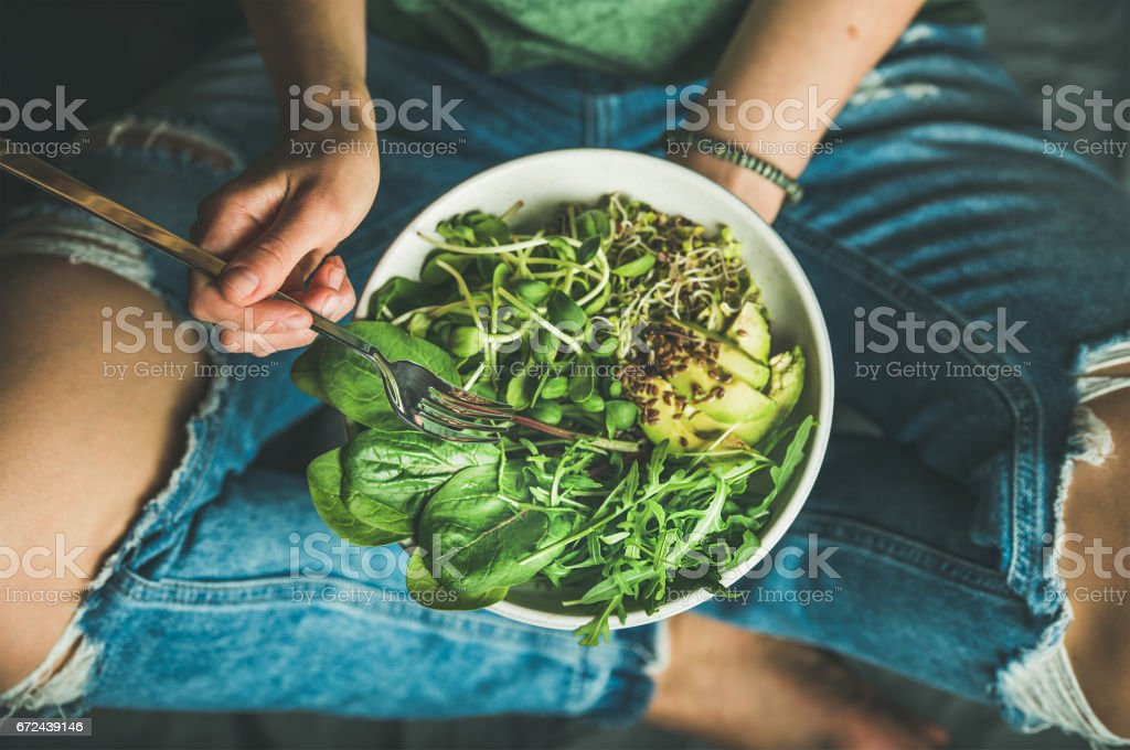 Vegetarian breakfast with spinach, arugula, avocado, seeds and sprouts stock photo