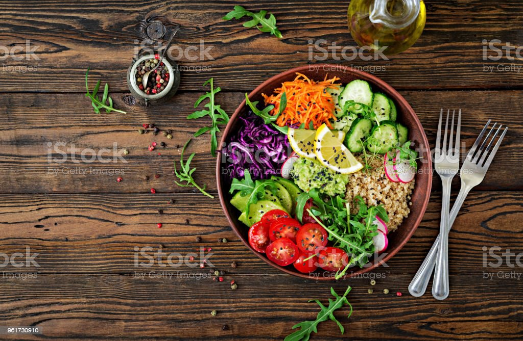 Vegetarian Buddha bowl with quinoa and fresh vegetables. Healthy food concept. Vegan salad. Top view. Flat lay stock photo
