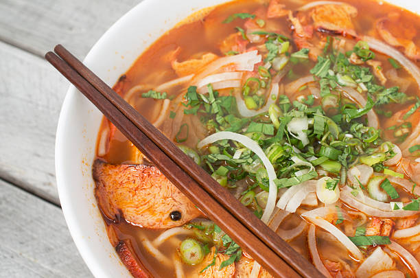 Vegetarian central Vietnamese hot and spicy soup Vegetarian central Vietnamese hot and spicy soup with a pair of chop sticks, Bun Bo Hue chay huế stock pictures, royalty-free photos & images