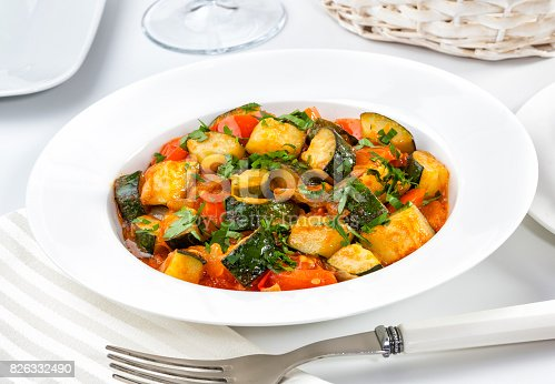 Vegetarian dish of zucchini and tomato.