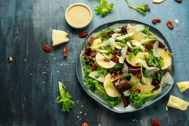 Vegetarian Fennel and apple salad with pecan nuts and Pecorino romano cheese shavings stock photo