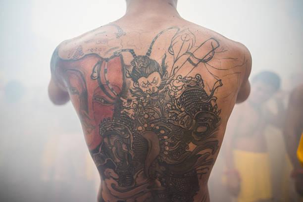 vegetarian festival - buddhist tattoos stock-fotos und bilder