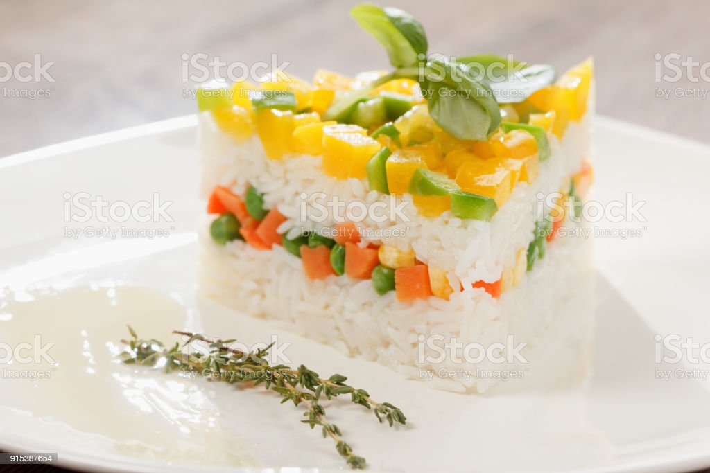 Vegetarian food, rice salad with vegetables, healthy meals stock photo