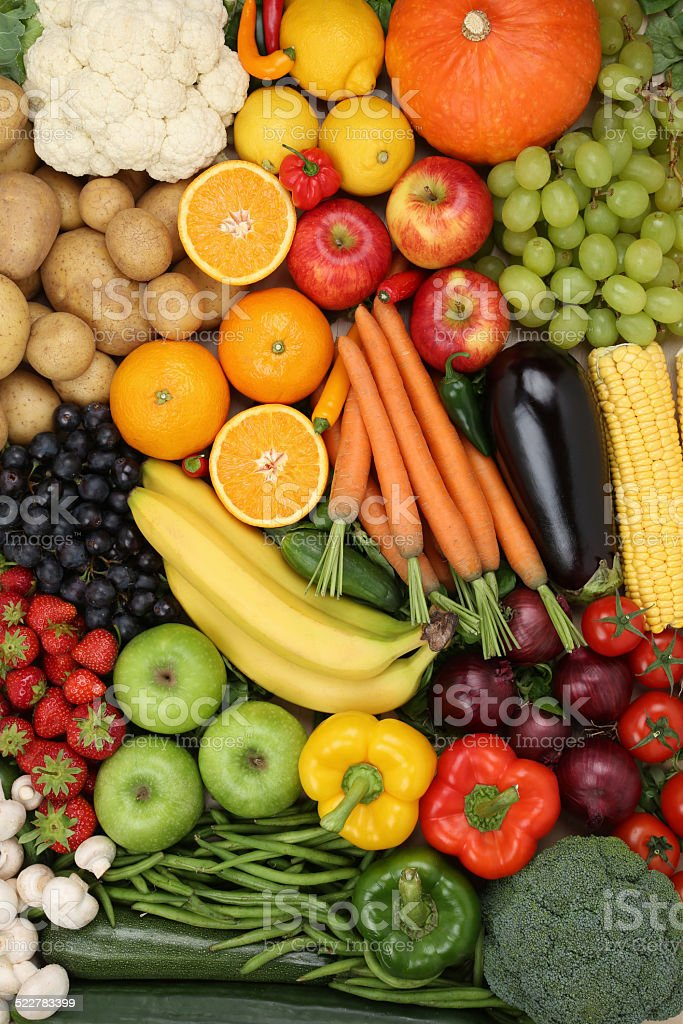 Vegetarian fruits and vegetables like apple, orange background stock photo