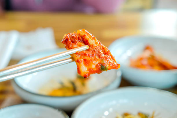 Vegetarian kimchi Unrecognized people eating kimchi as appetizer during lunch kimchee stock pictures, royalty-free photos & images