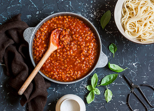 Vegetarian lentil bolognese sauce in a frying pan stock photo
