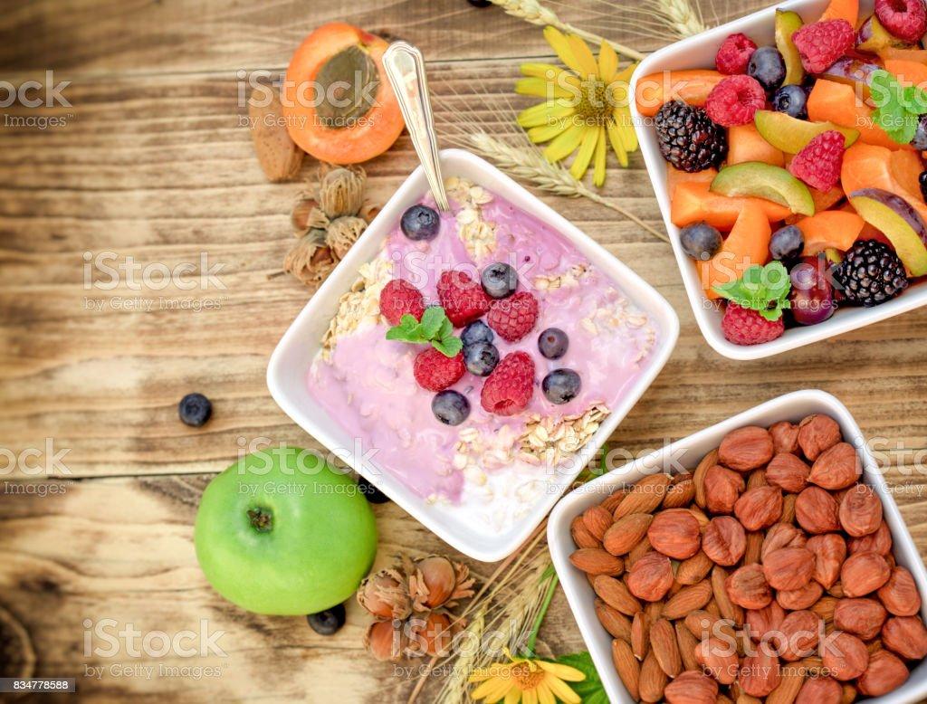 Vegetarian meal - oatmeal with fruit yogurt stock photo