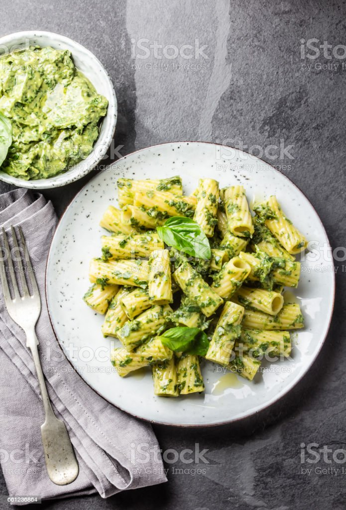 Vegetarian pasta with avocado and herb sauce stock photo