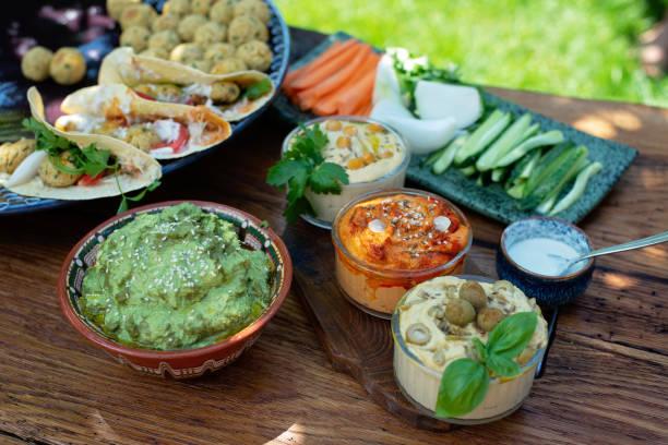 Vegetarian picnic on a wooden oak table hummus falafel pita spinach picture id1254737513?b=1&k=6&m=1254737513&s=612x612&w=0&h=pjgptm rwcylugr2opr21fj1iznn7nlyauiwfoyyuek=