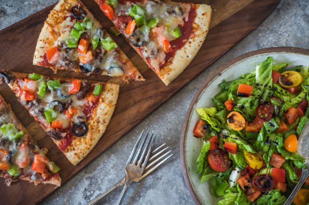 Vegetarian Pizza and Salad stock photo