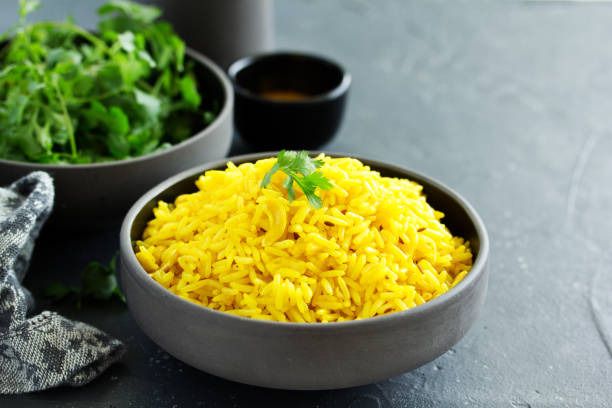 Vegetarian rice with curry and cashew nuts. stock photo