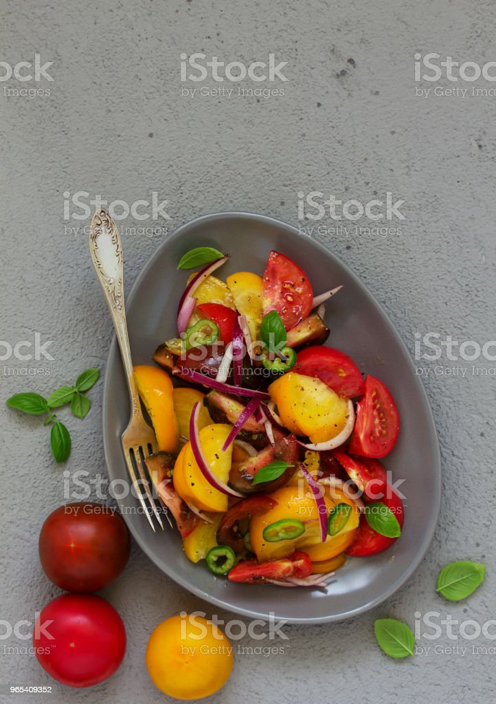 Vegetarian salad with fresh tomato, with red onion, basil and olive oil. royalty-free stock photo