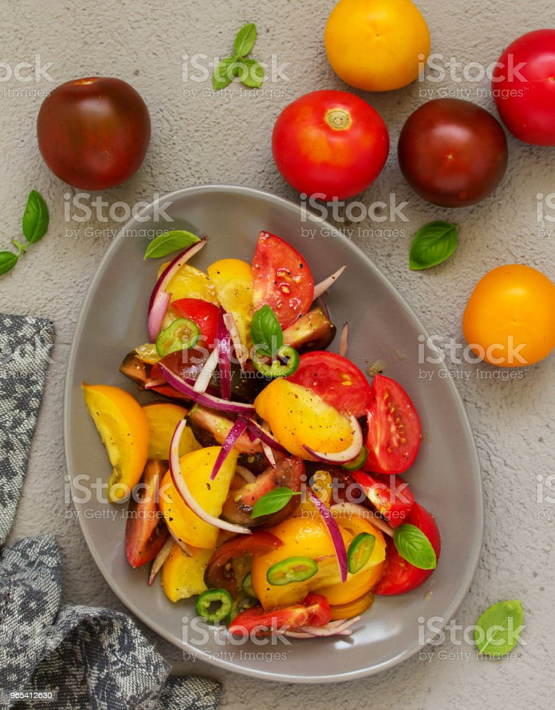 Vegetarian salad with fresh tomato, with red onion, basil and olive oil. zbiór zdjęć royalty-free