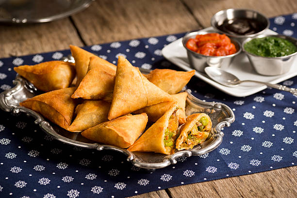 vegetarian samosas with chutney - samosa stock photos and pictures