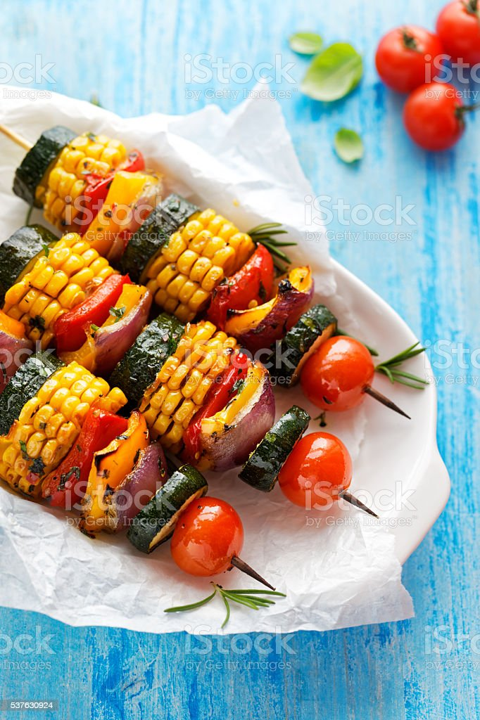 Vegetarian skewers with organic vegetables on a white plate stock photo