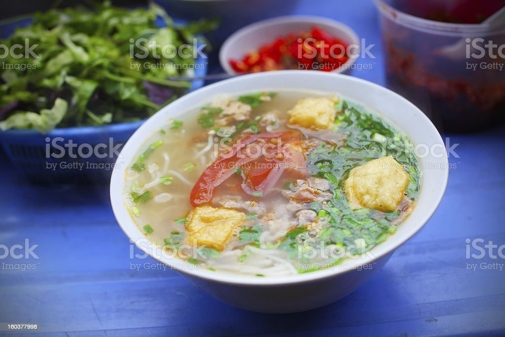 Vegetarian soup with fried tofu, tomato and scallion royalty-free stock photo