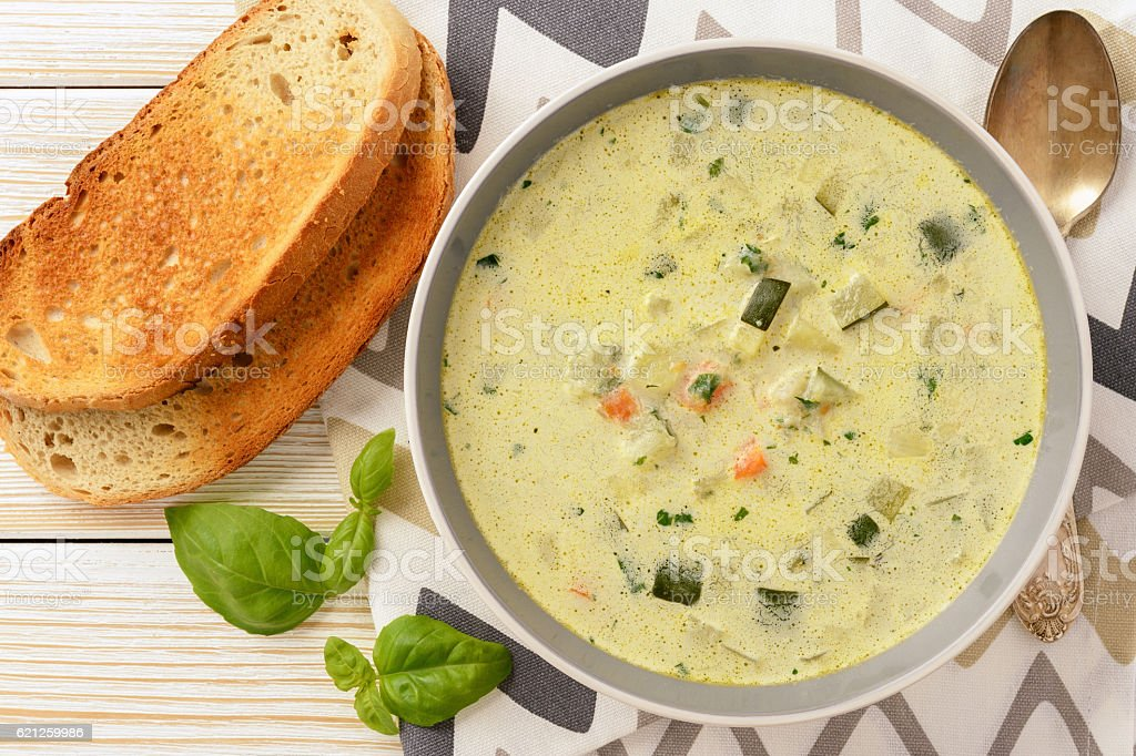 Vegetarian soup with zucchini, carrot and potatoes. stock photo