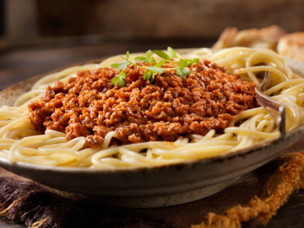 Vegetarian Spaghetti Bolognese with Plant Based Protein Meat Substitute Vegetarian Spaghetti Bolognese with Plant Based Protein Meat Substitute bolognese sauce stock pictures, royalty-free photos & images