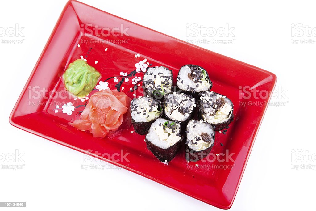 Vegetarian sushi roll served on a red plate royalty-free stock photo