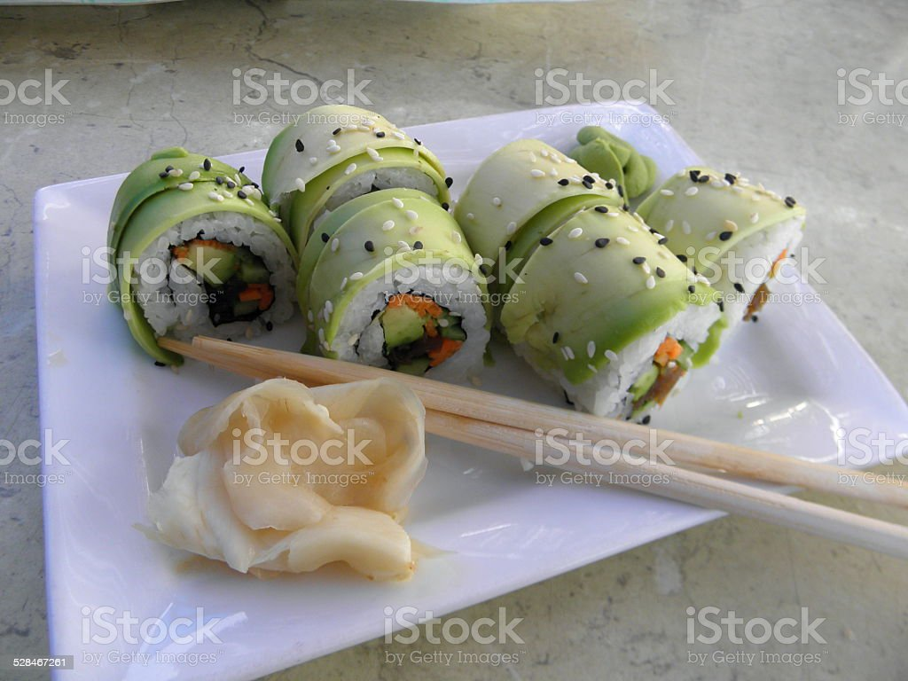 Vegetarian sushi - roll with vegetables served with ginger and wasabi. stock photo