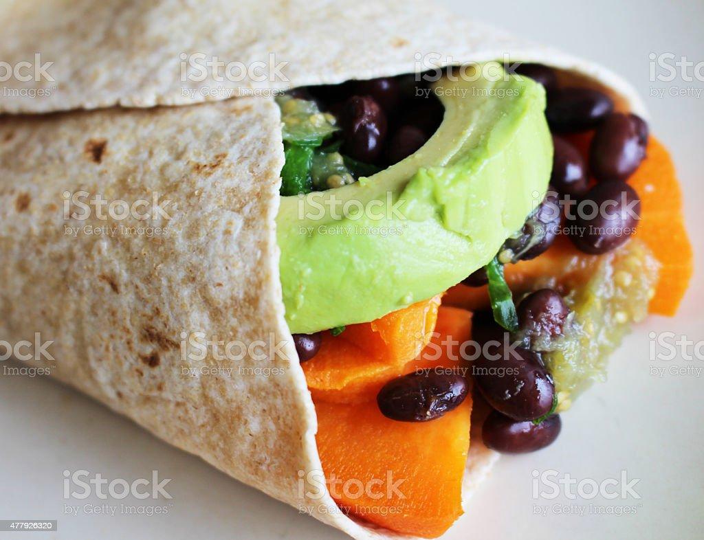 Vegetarian sweet potato burrito stock photo