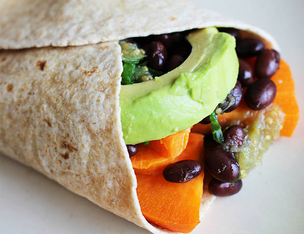 Vegetarian sweet potato burrito stock photo