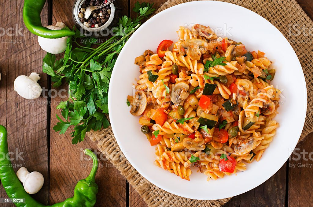 Vegetarian Vegetable pasta Fusilli with zucchini, mushrooms and capers stock photo