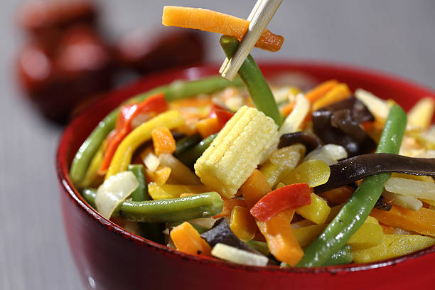 Vegetarian wok with bamboo and corn stock photo