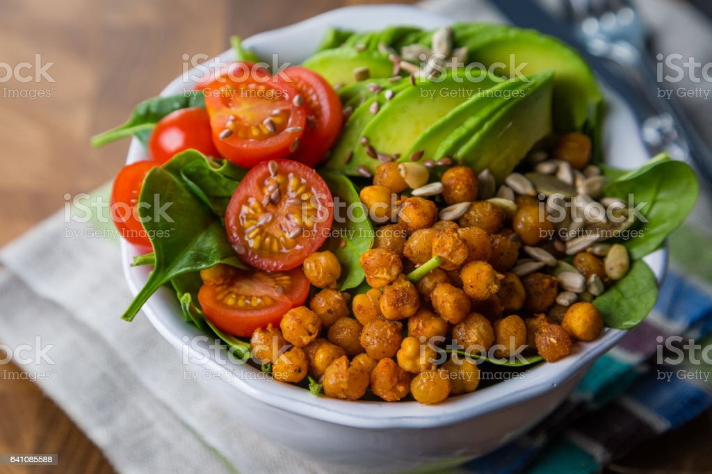 Vegeterian buddha bowl - balanced meat with spinach, chicken pea and avocado stock photo