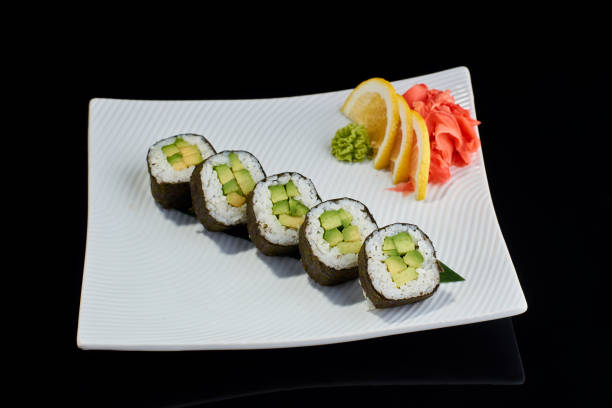 Vegeterian sushi roll with avocado stock photo