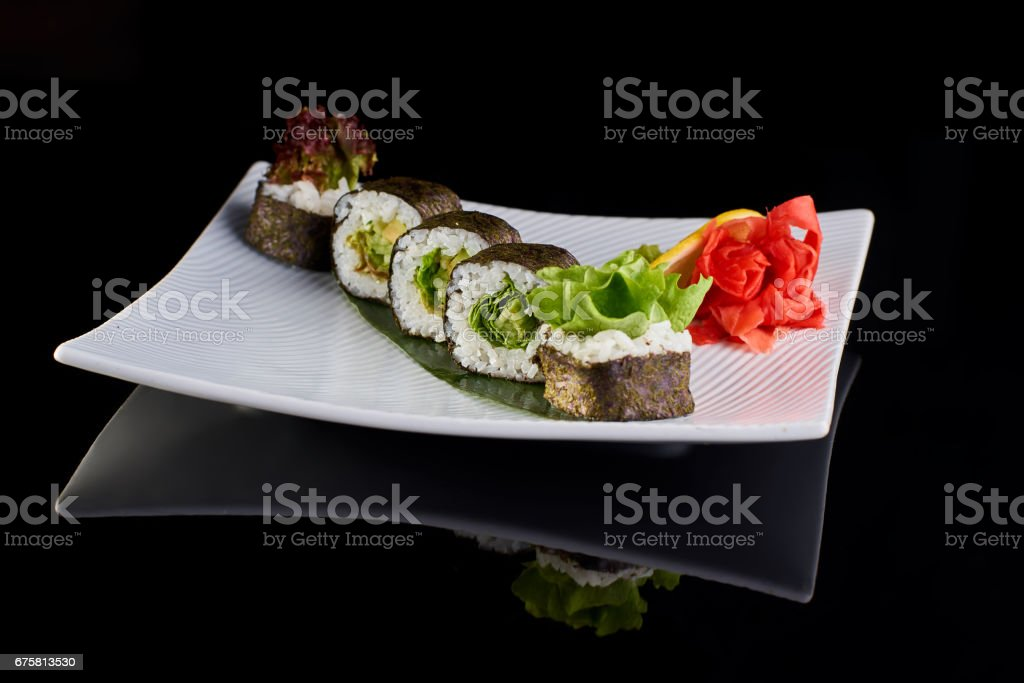 Vegeterian sushi roll with lettuce stock photo