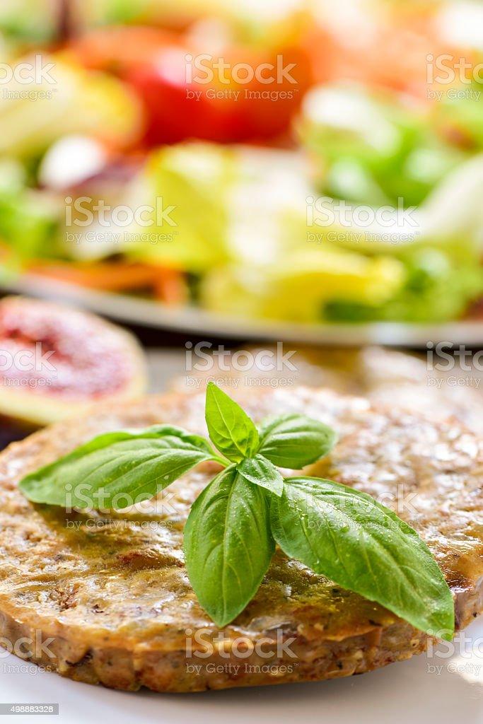 veggie burger and salad stock photo