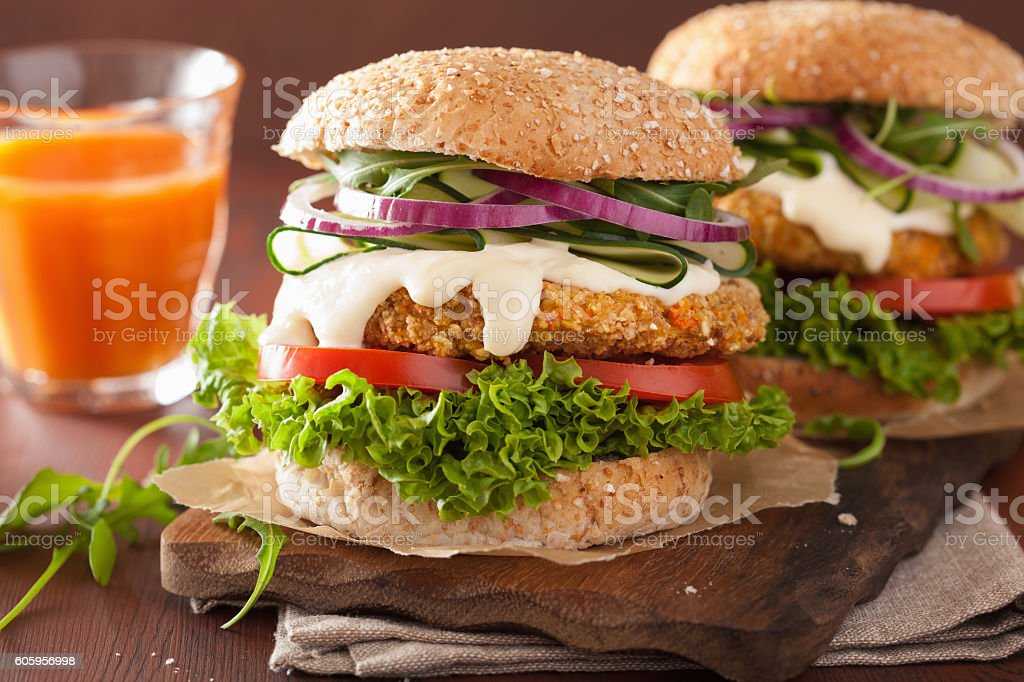 veggie carrot and oats burger with cucumber onion stock photo